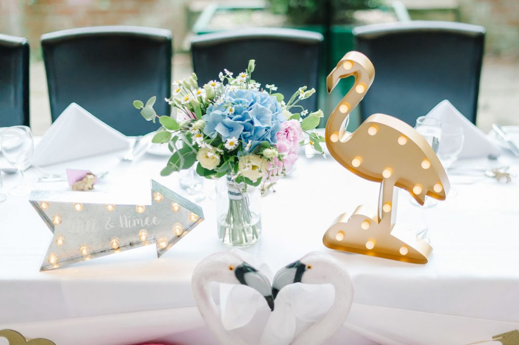 table decoration and flowers at reception