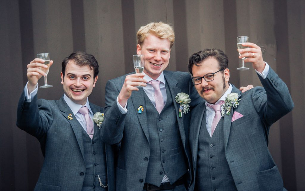 groom and bestman toasting with glasses