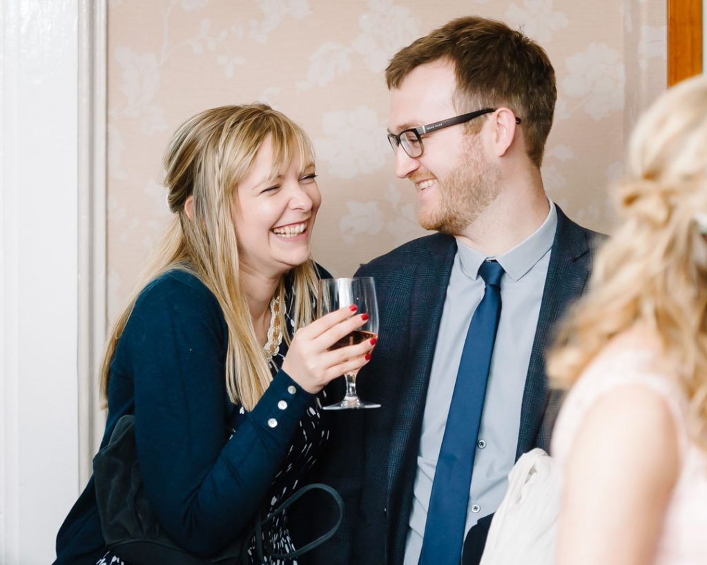 woman laughing at partner at Charlotte house wedding venue