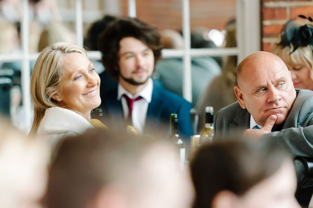guests laugh at Charlotte house hotel wedding venue