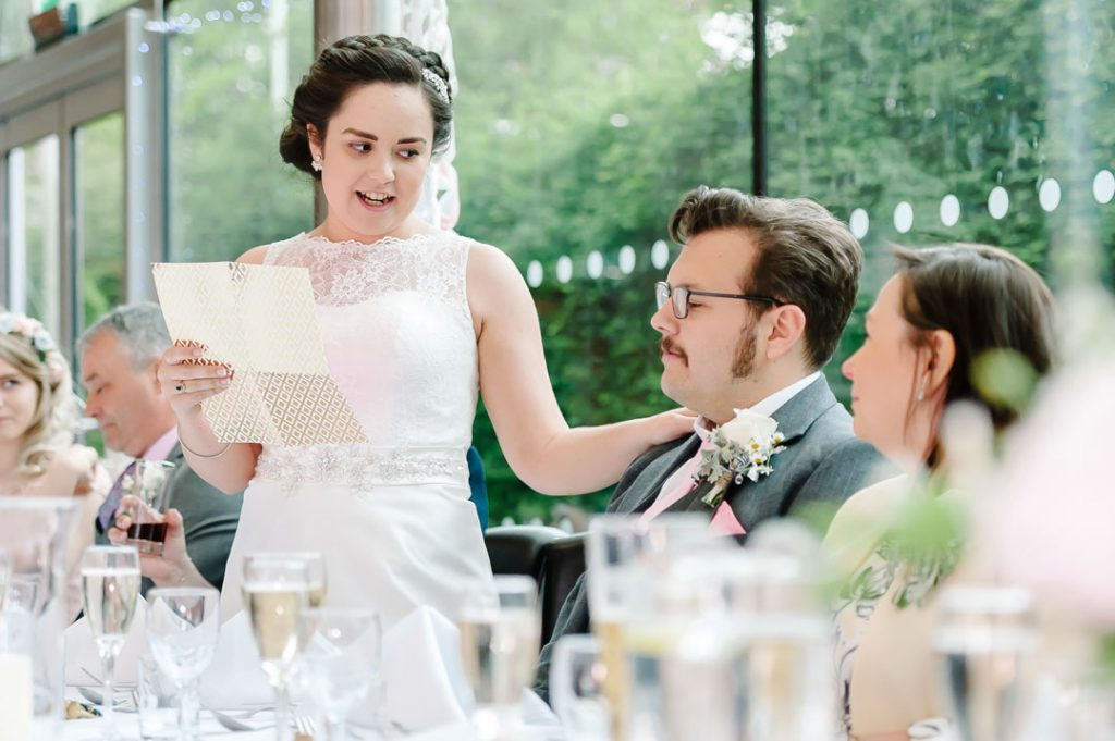 bride reading speech to groom