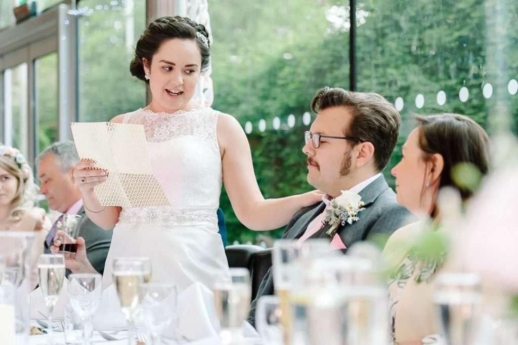 bride reading speech to groom