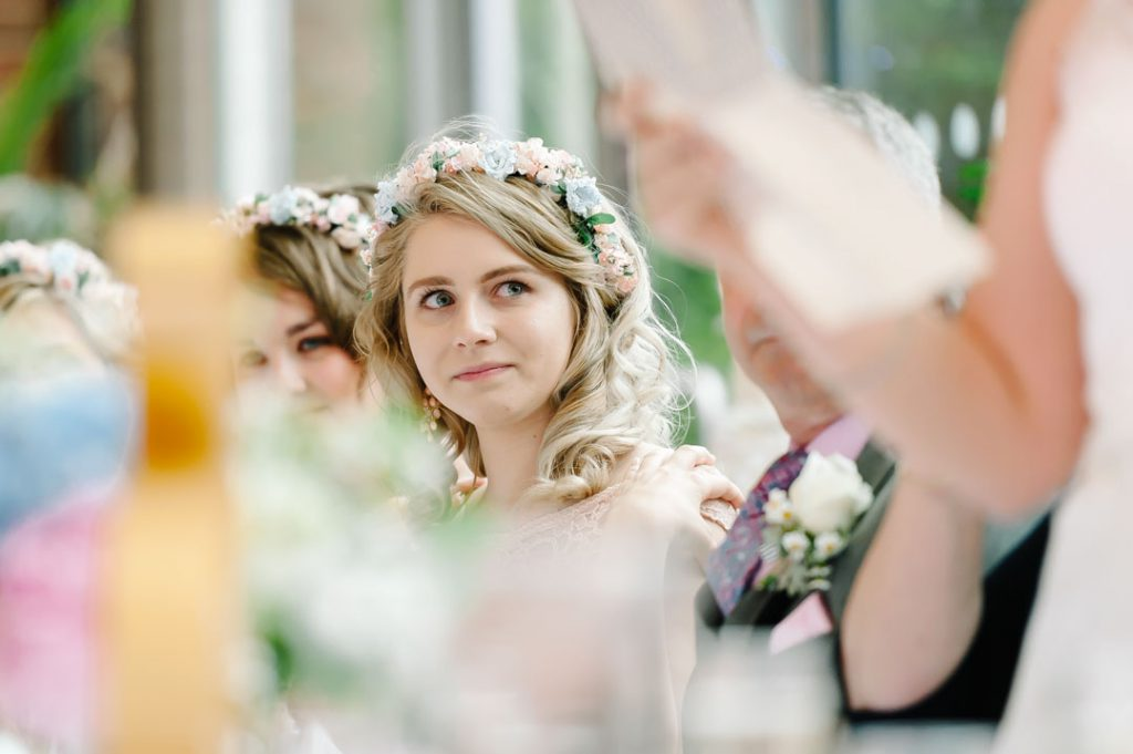 bridesmaid sat listening to wedding speech