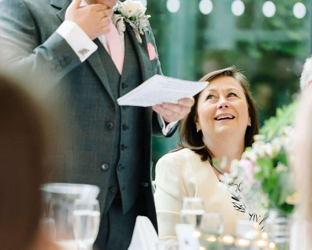 groom reding speech to guest