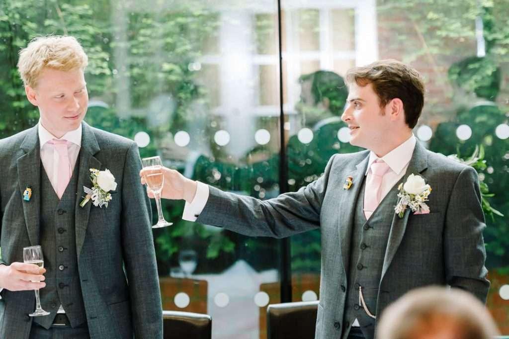 bestman toasts bride and groom