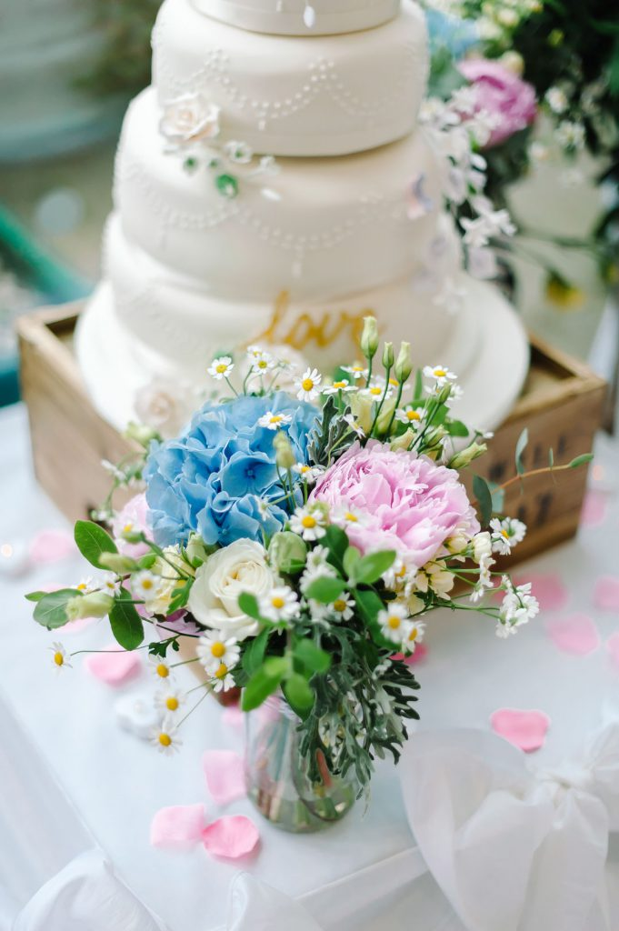 flowers in front of wedding cake