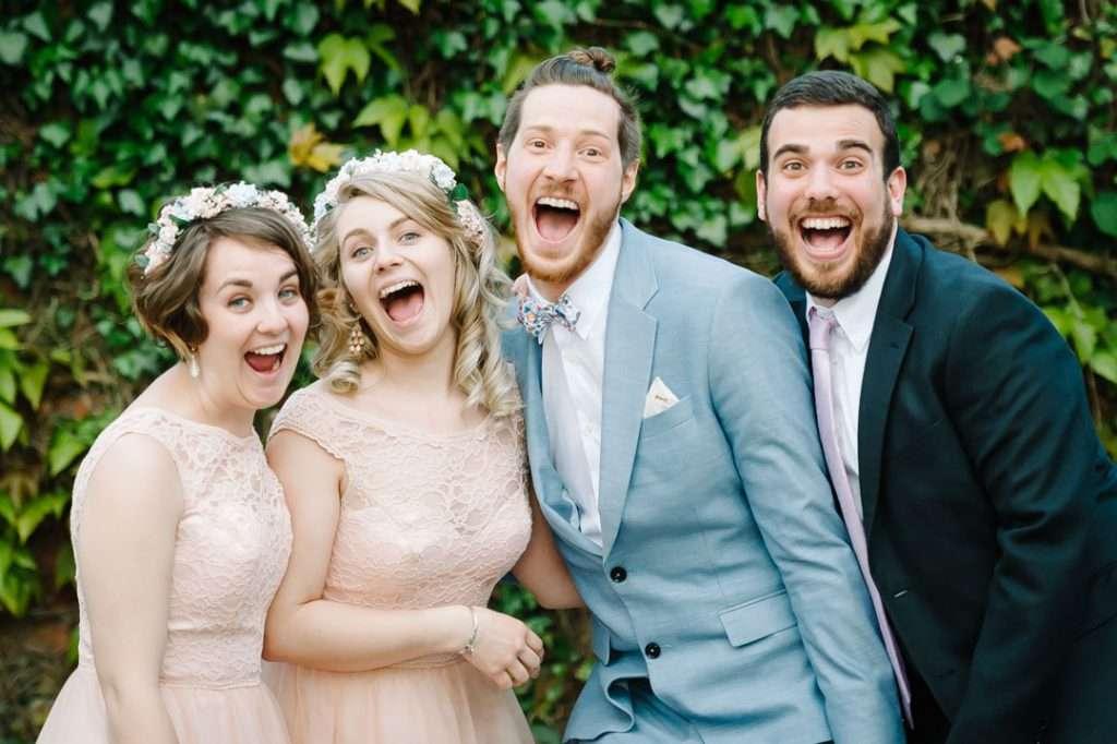 wedding guests pulling funny faces at camera