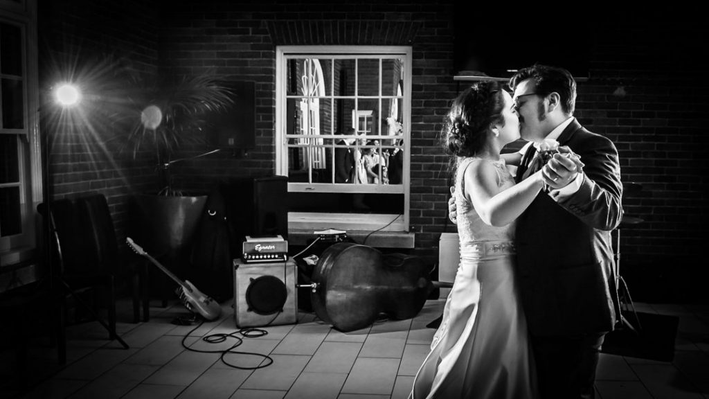 bride and groom dancing and kissing