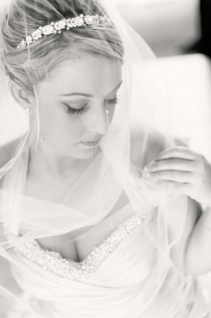 bride adjust wedding veil