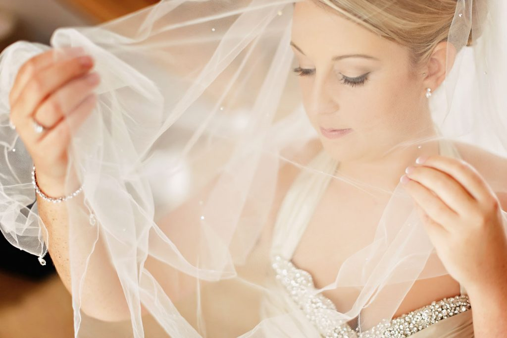 bride adjusting wedding veil