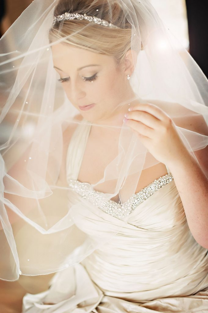bride puts on veil