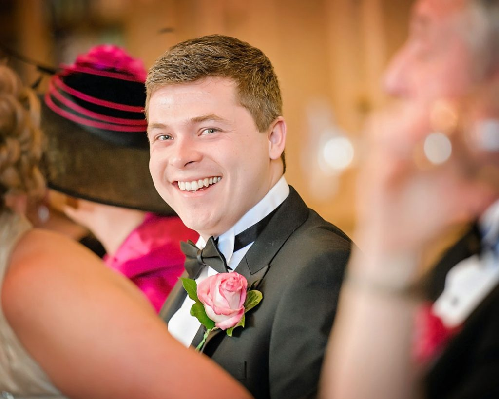groom laughing at Grantham wedding photographer