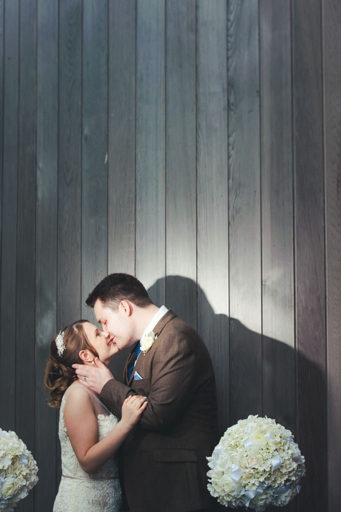 groom kissing bride on lips