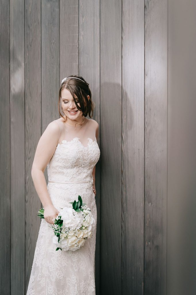 bride holding flowers looking down