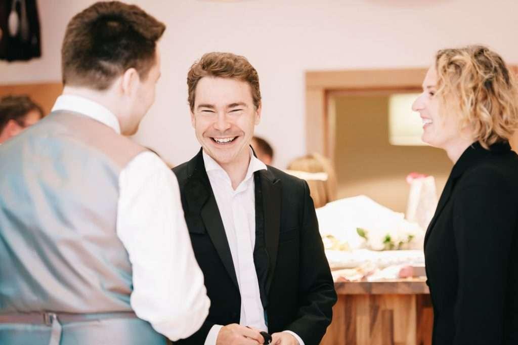 wedding guest in black suit
